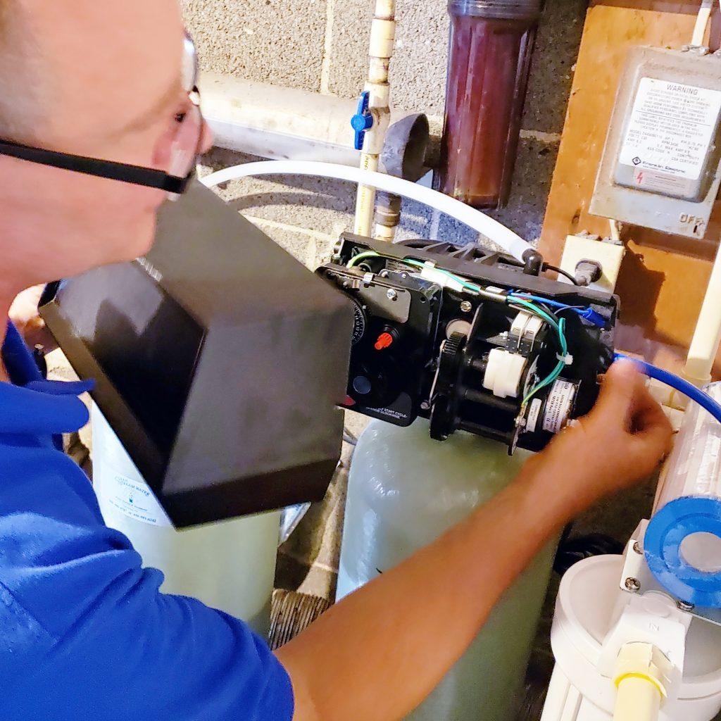 Technician working on water softener