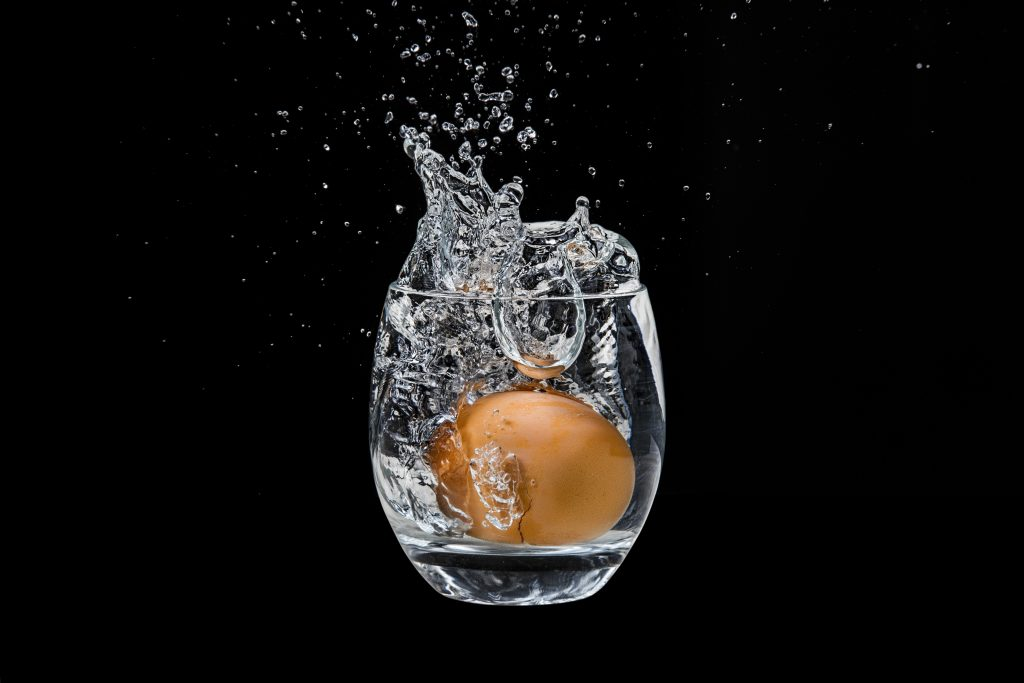 Egg dropped in glass of water